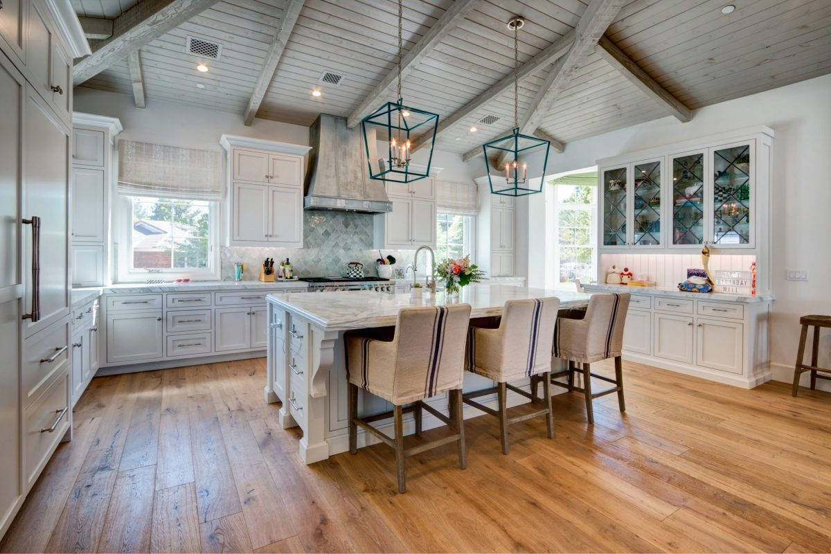 remodeled white kitchen with cathedral ceiling