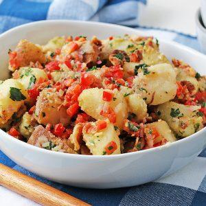 bacon mustard potato salad in a bowl