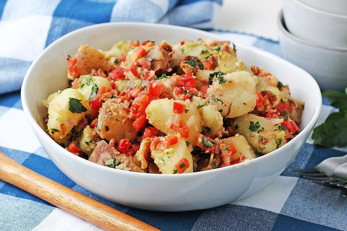 homemade potato salad on a blue checkered linen