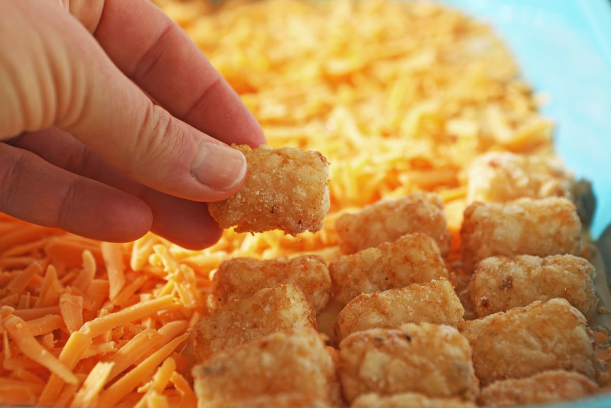 hand placing frozen tater tot