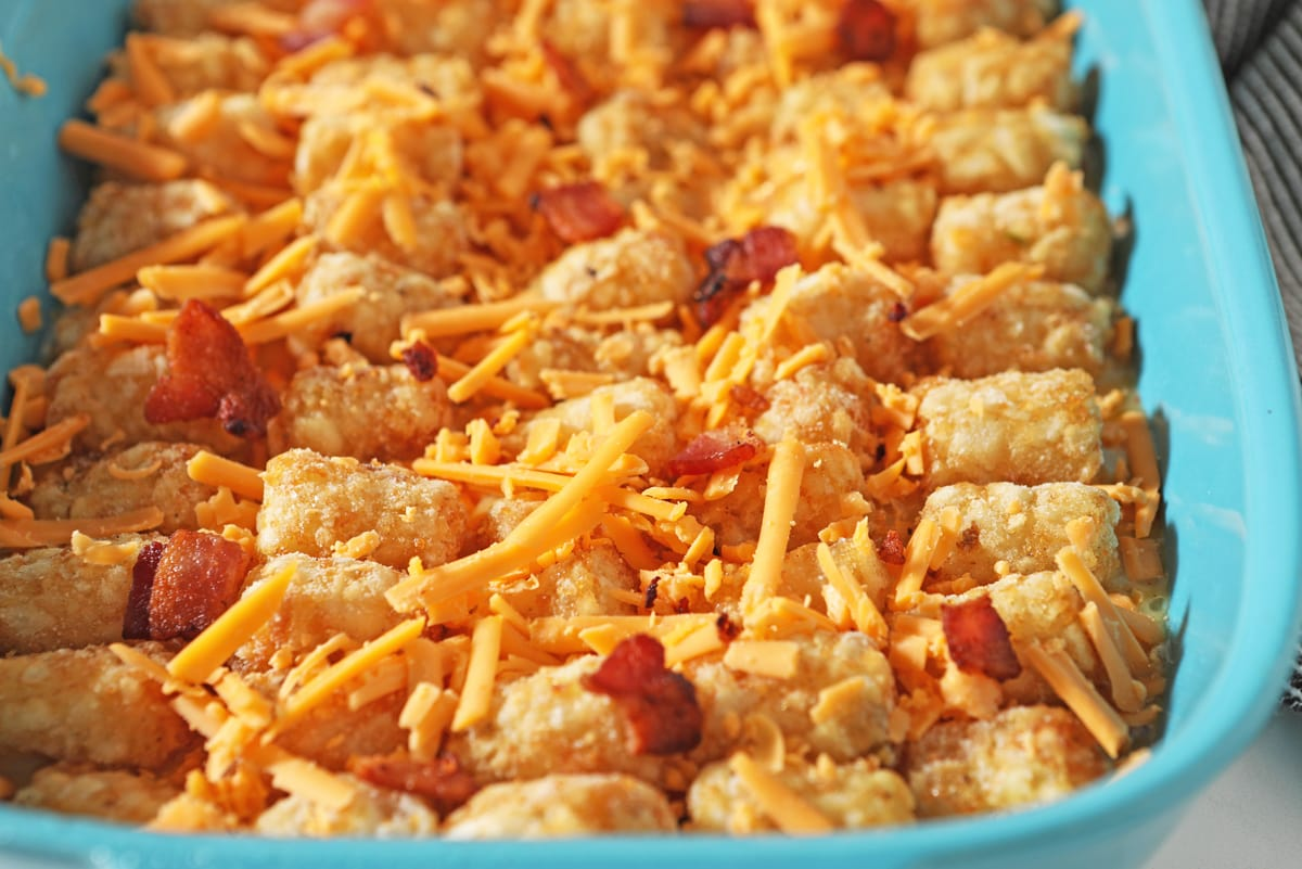 tater tots with cheese and bacon in a baking dish