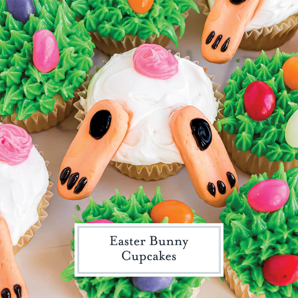 close up of bunny butt cupcake in grass with jelly beans