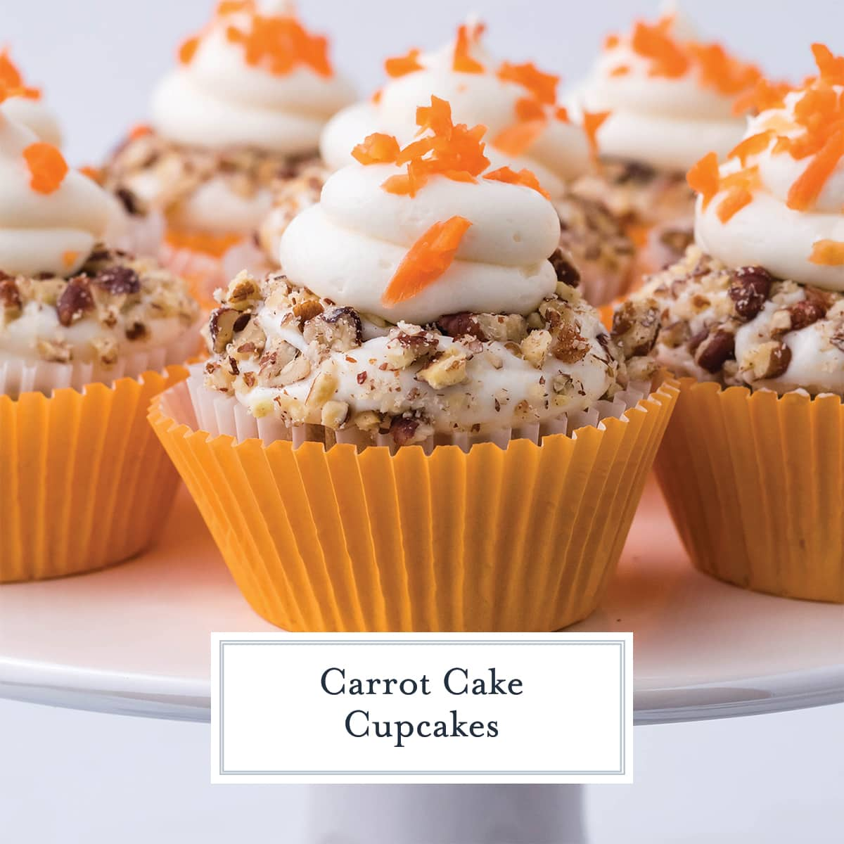 close up of carrot cake cupcakes with carrot topping