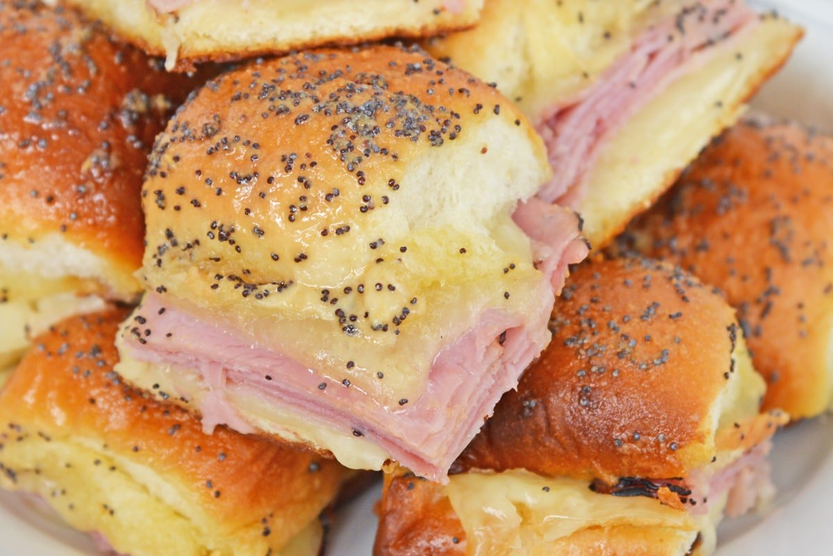 close up of buttery ham and cheese sandwich