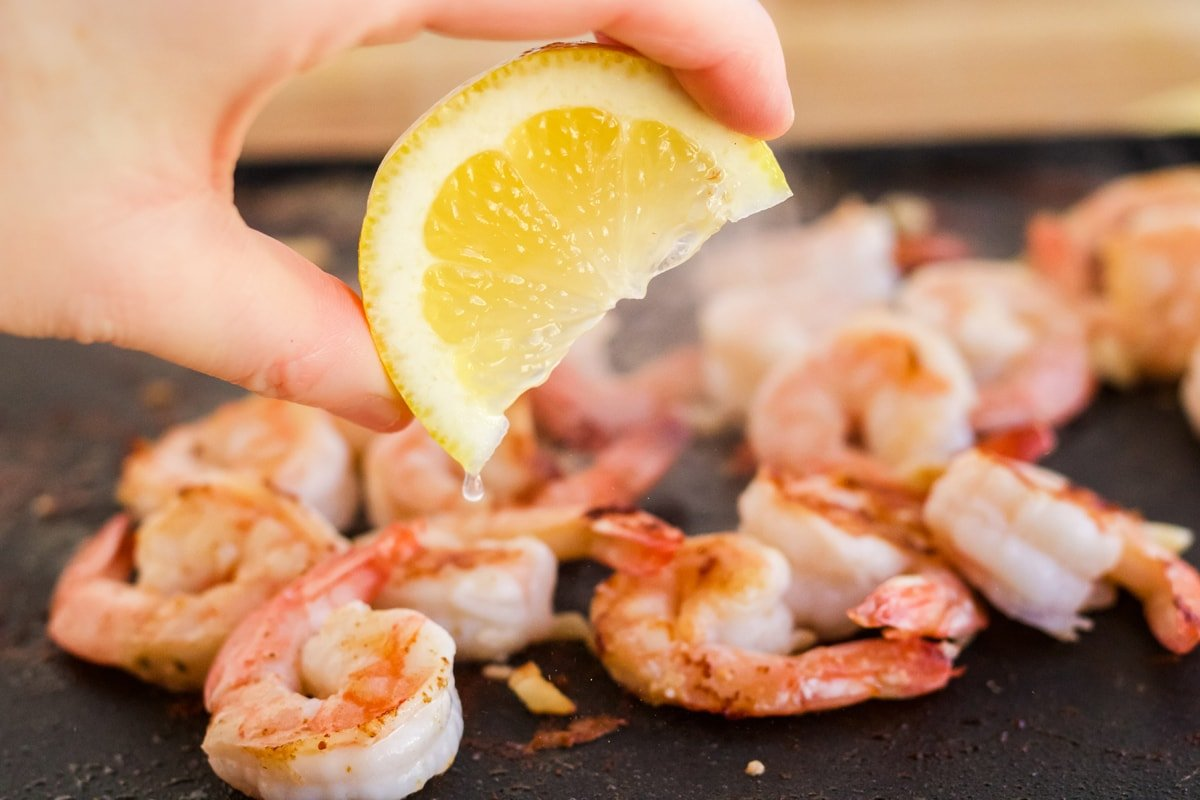 squeezing lemon on to hibachi shrimp