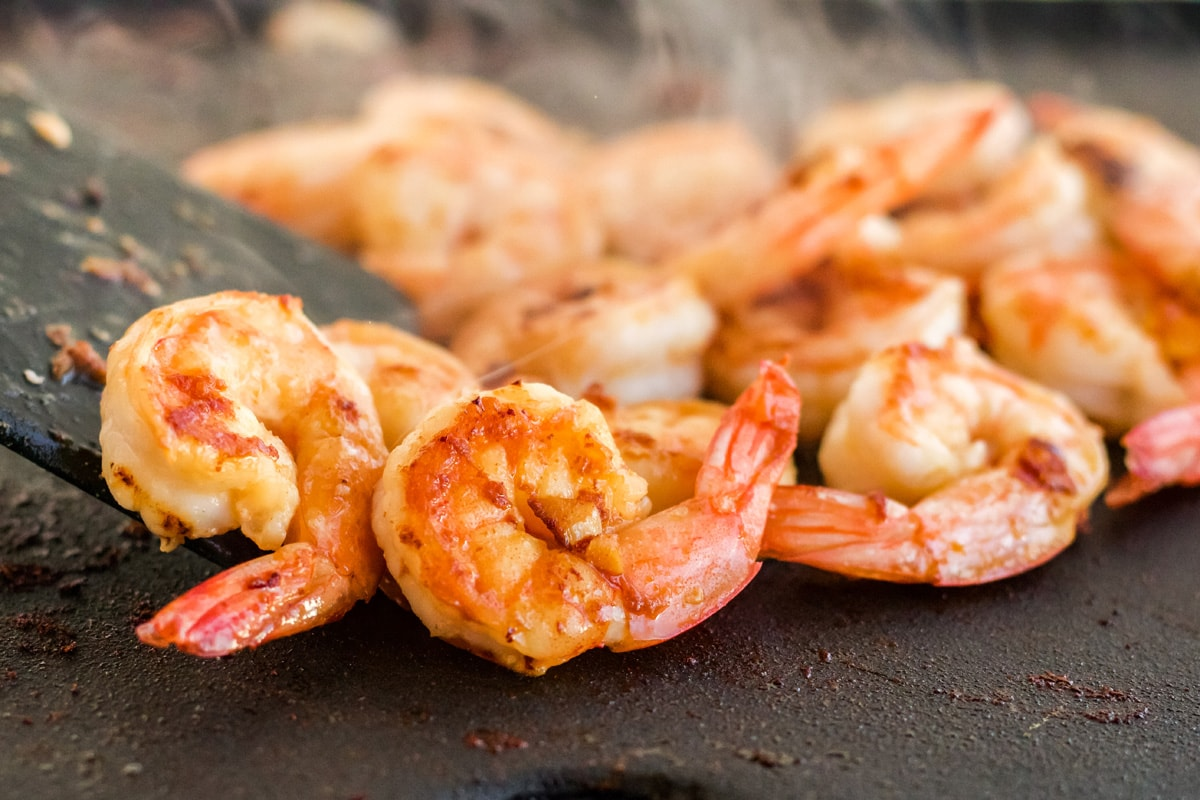 close up of shrimp on a griddle