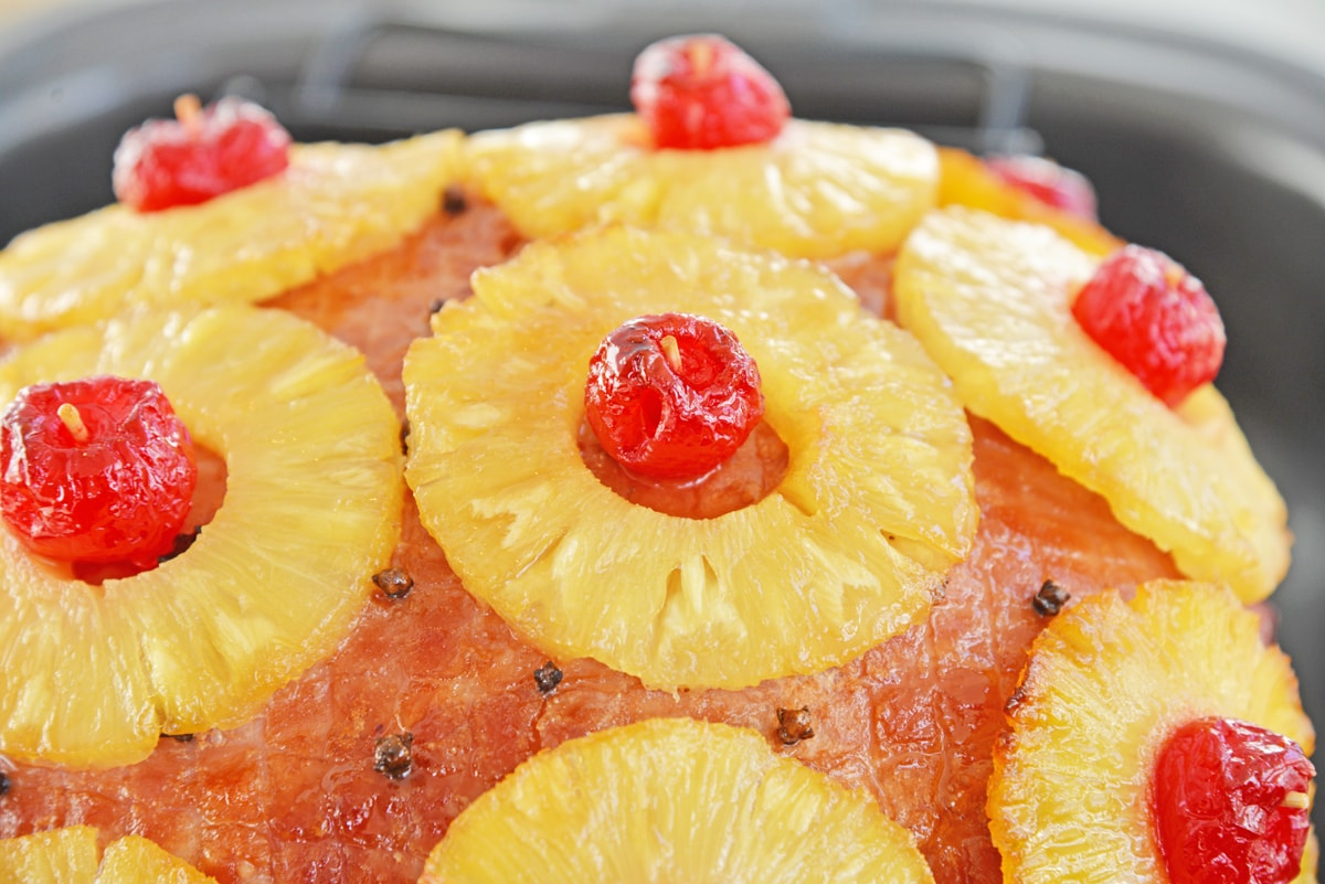 Close up of caramelized pineapples and cherries on a ham