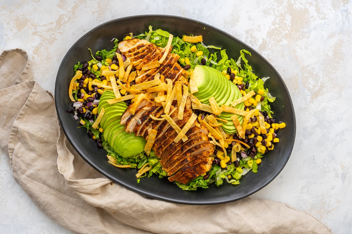 overhead of southwest chicken salad on an oval plate