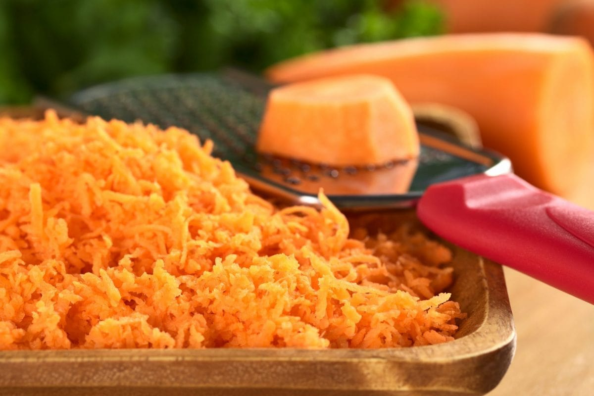 grated carrot on a wood plate