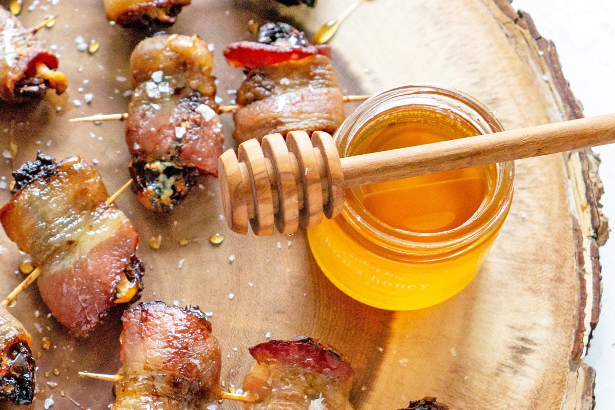 close up of honey pot with honeycomb