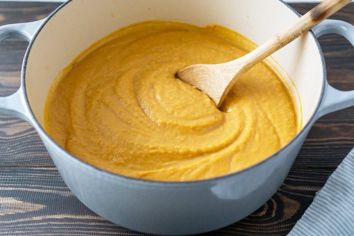butternut squash soup in a blue dutch oven