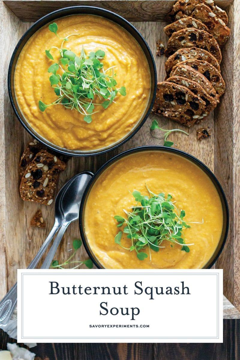 serving two bowls of garnished butternut squash soup