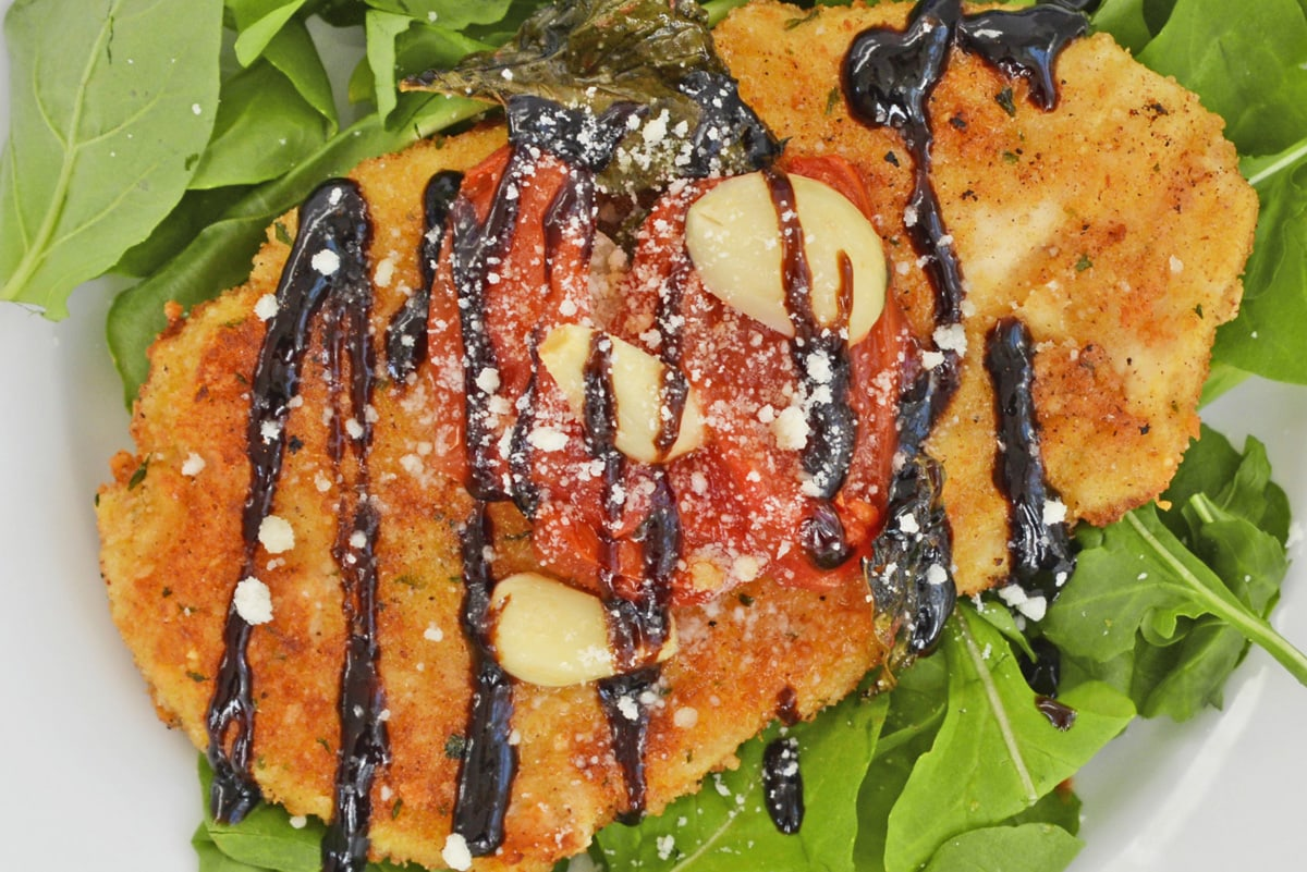 close up of chicken cutlet with sauce