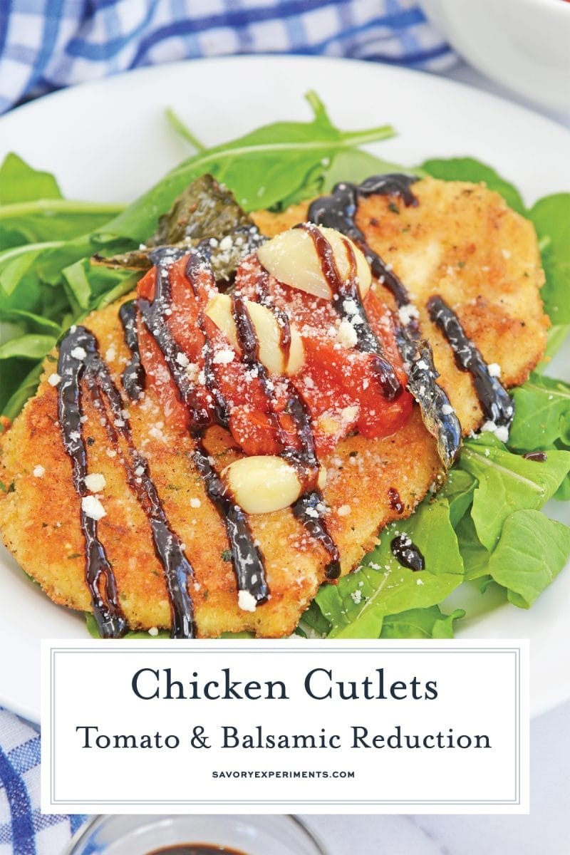 close up of chicken cutlets with tomatoes and garlic