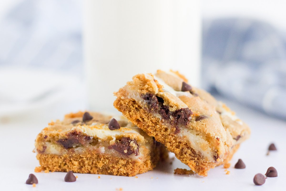 two cheesecake bars with chocolate chips