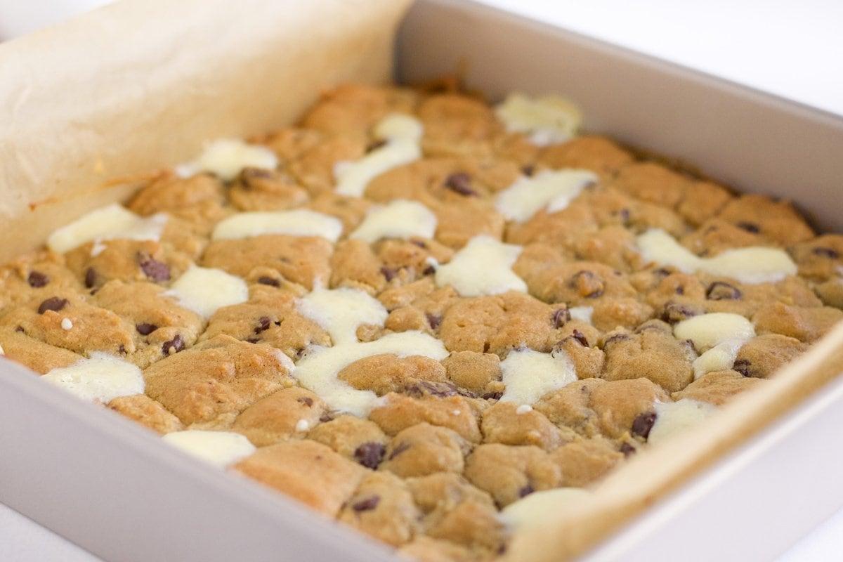overhead of cheesecake bars in baking pan