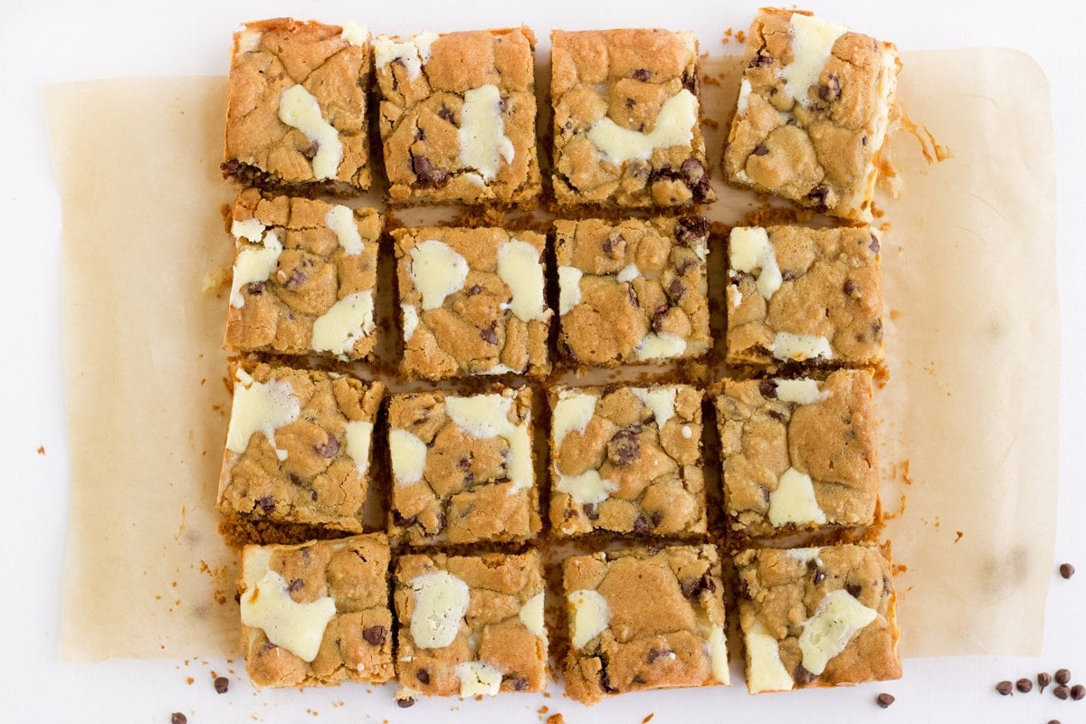 chocolate chip cookie cheesecake bars cut into 16 pieces