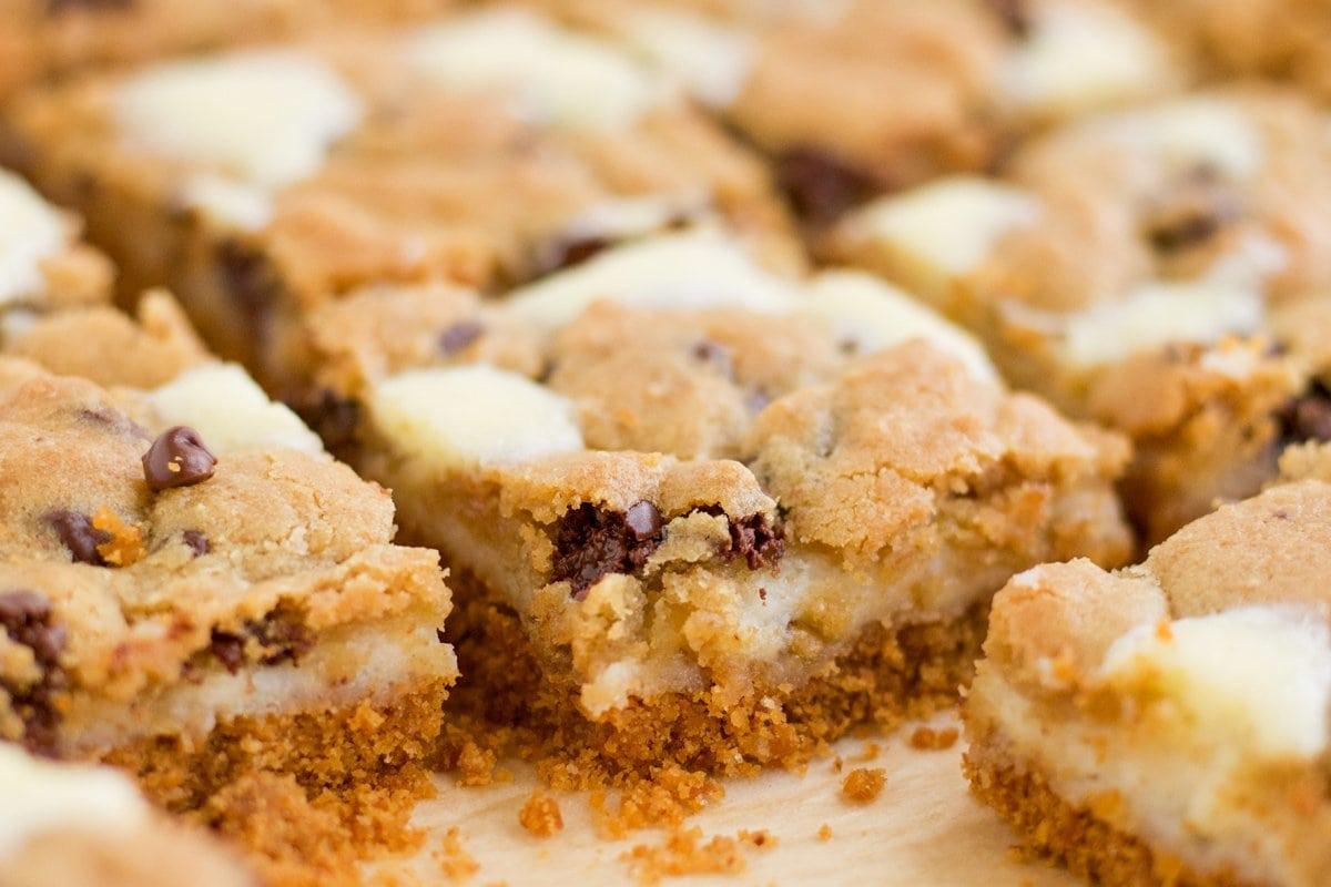 close up corner of chocolate chip cookie cheesecake bar