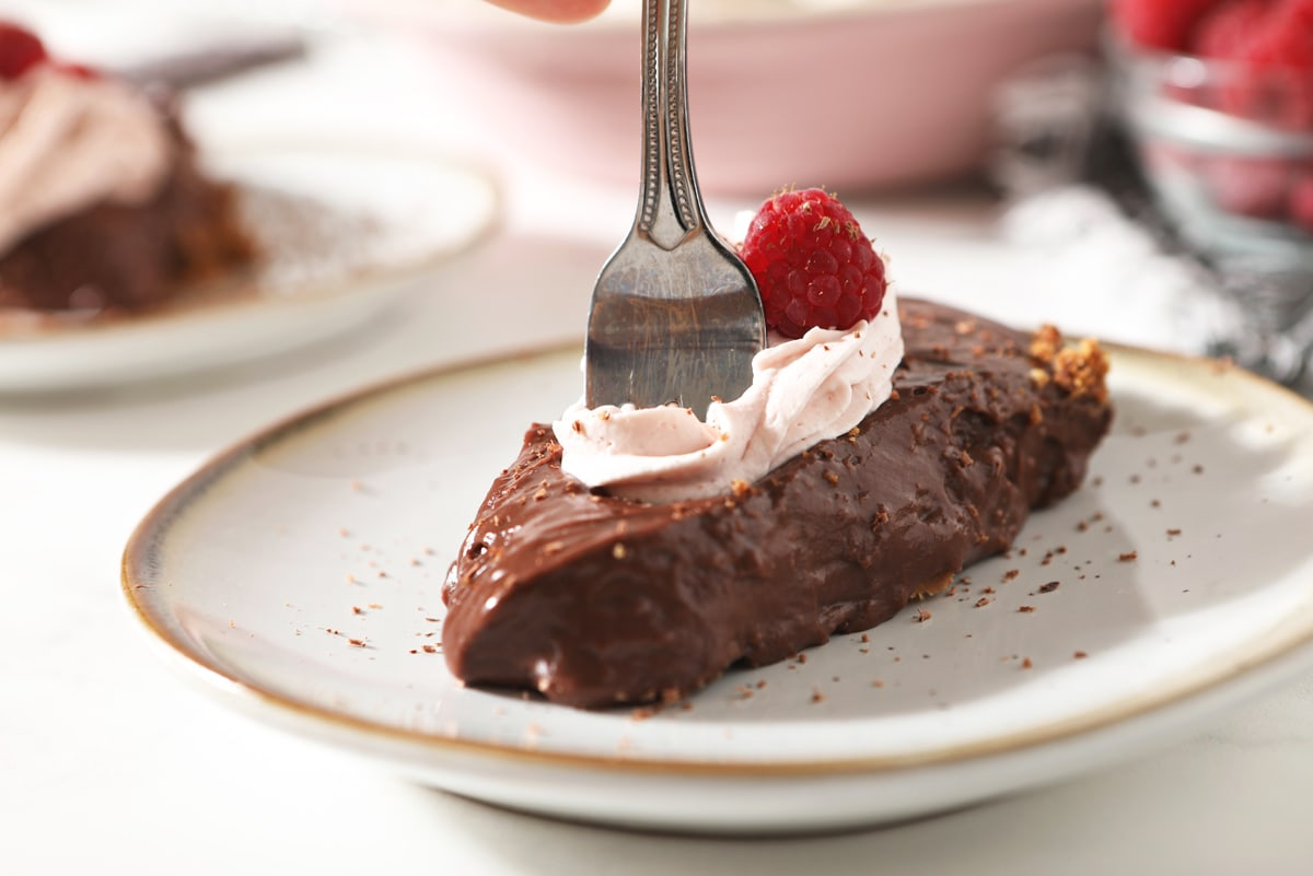 fork dipping into a piece of chocolate pie
