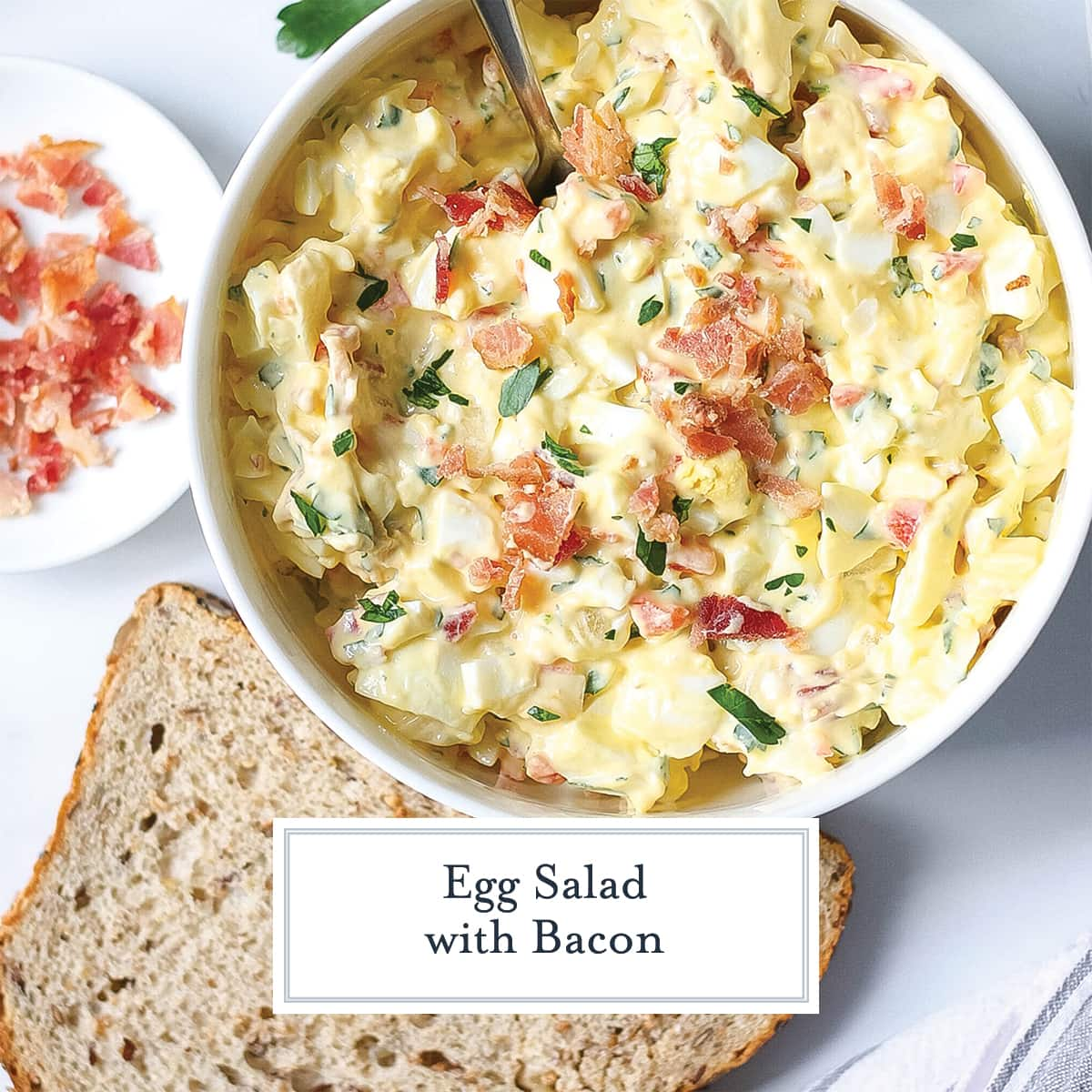 egg salad with a slice of bread and crumbled bacon
