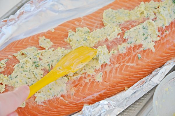 slathering salmon with butter