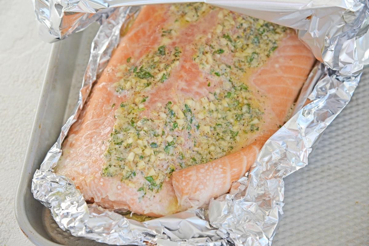 unwrapping salmon baked in aluminum foil