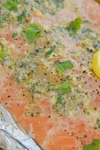 close up of garlic butter baked salmon in foil