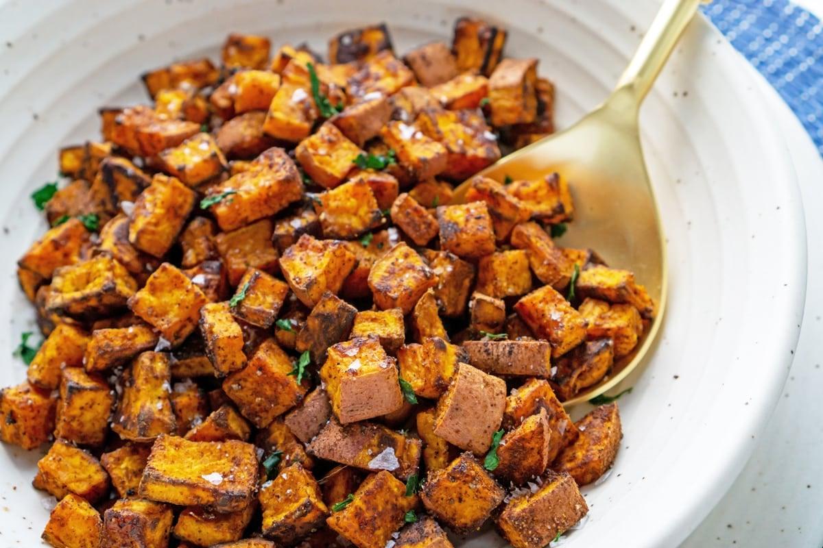 seasoned crispy sweet potatoes in a serving bowl