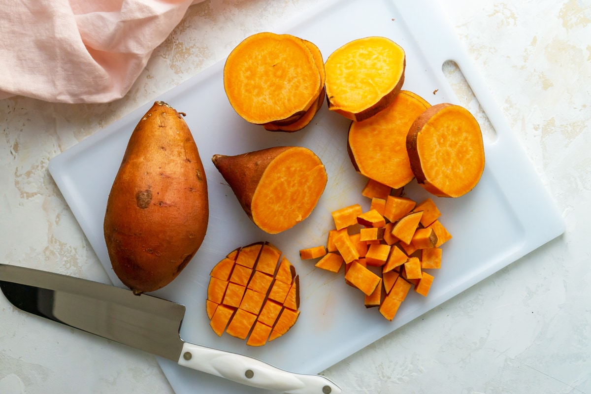 how to cut up a sweet potato on a cutting board