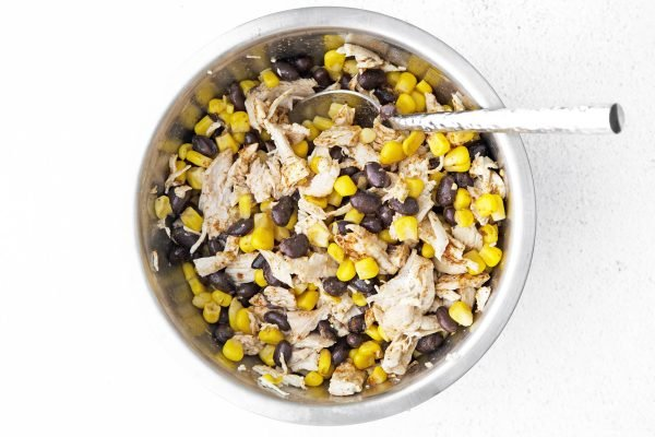 corn, beans and chicken in a bowl