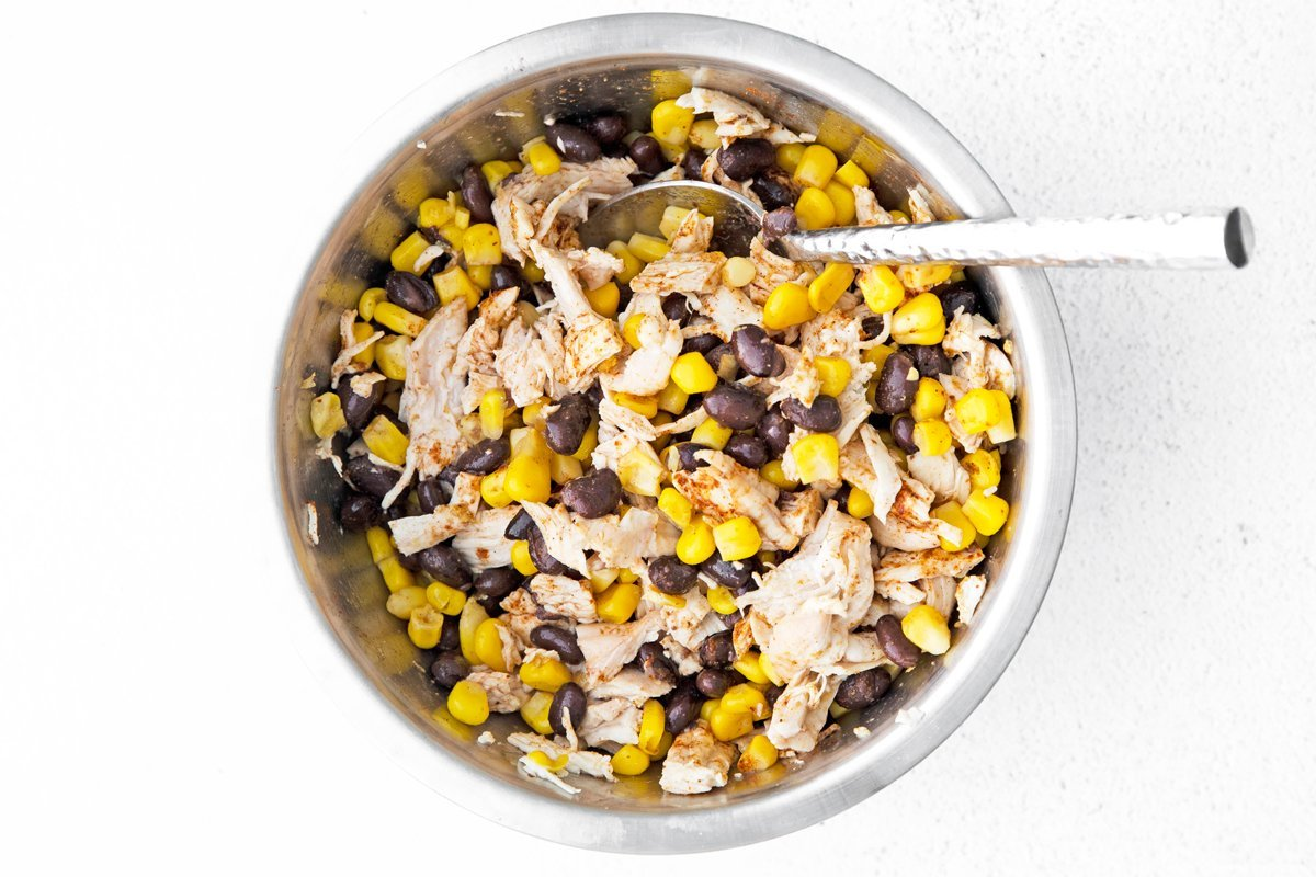 corn, chicken and bean quesadilla filling in a mixing bowl