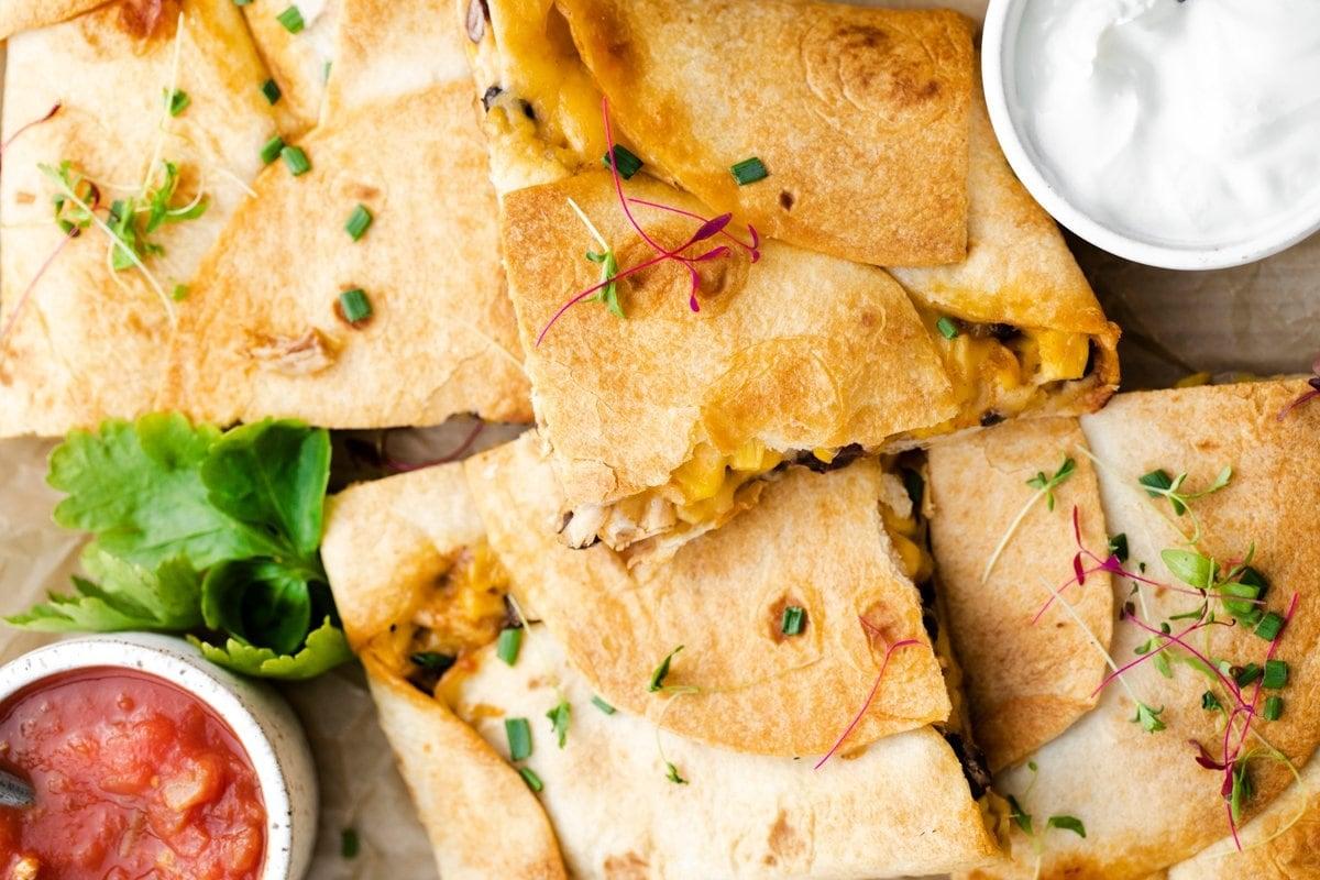 close up of garnished sheet pan quesadillas