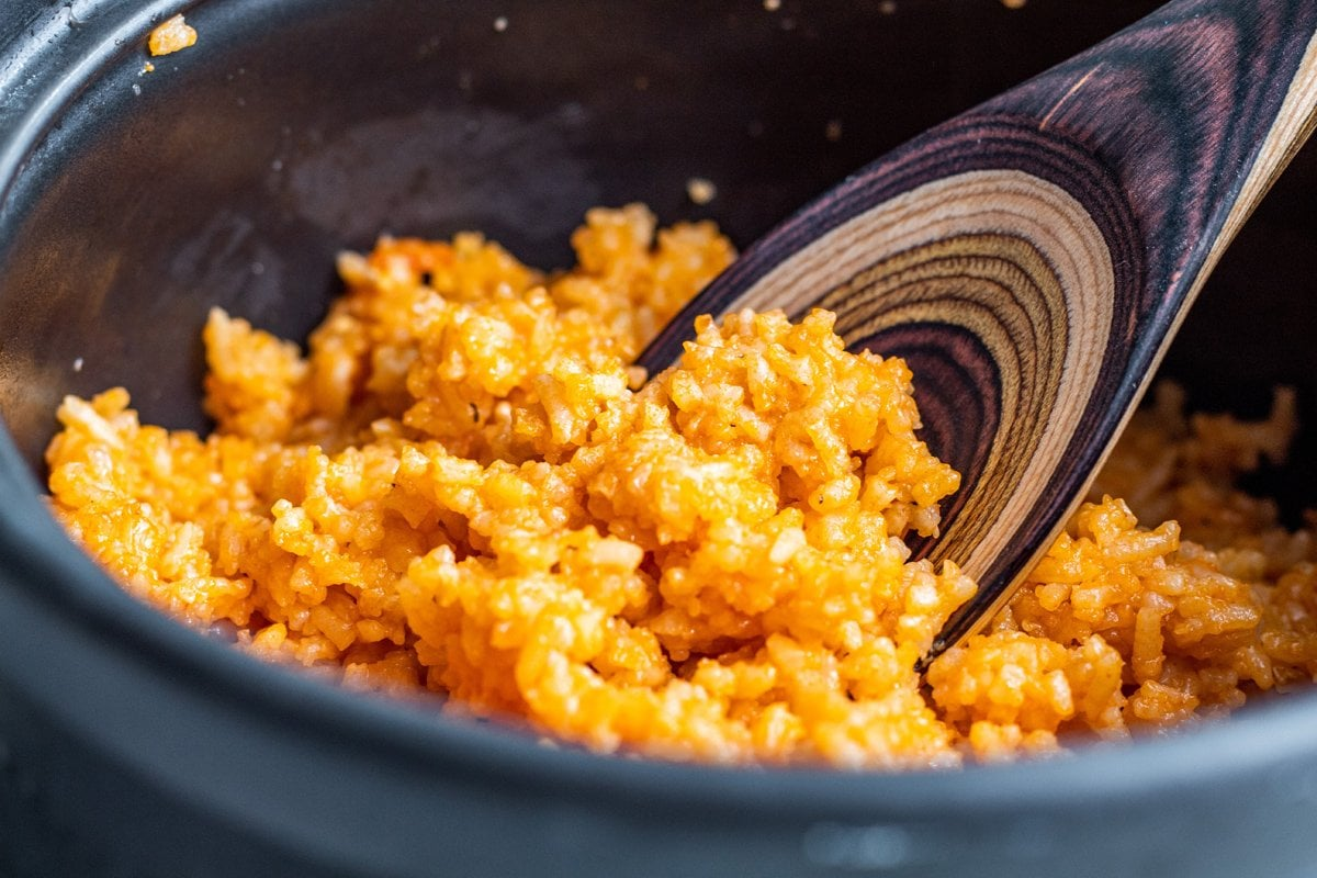 wooden spoon with spanish rice