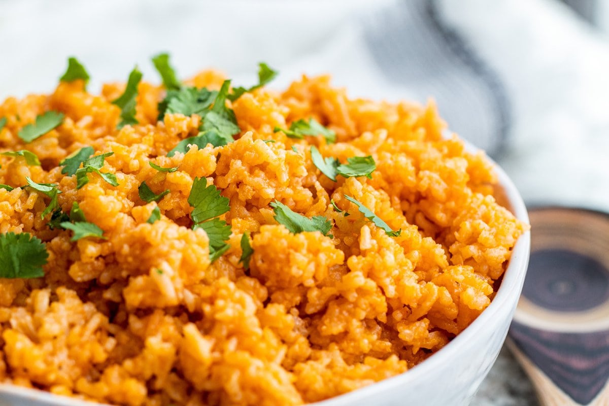 close up angle of spanish rice in a white bowl