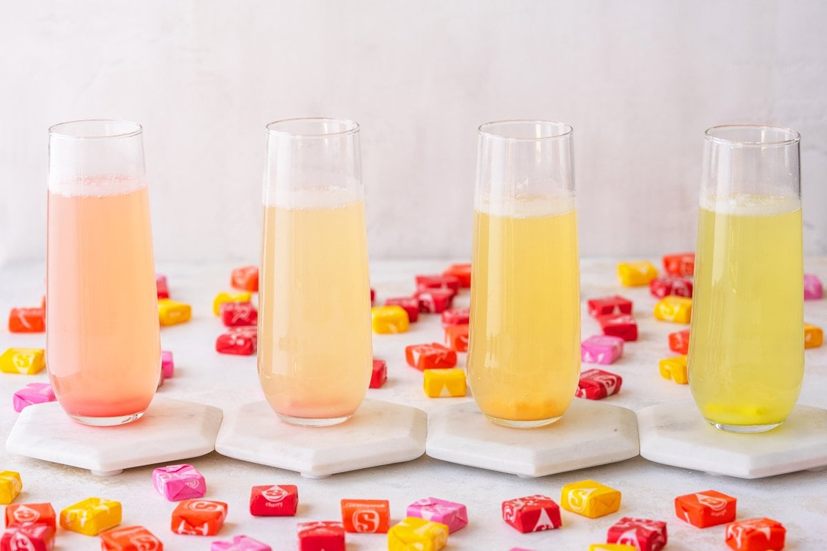 four champagne cocktails- pink, orange and yellows