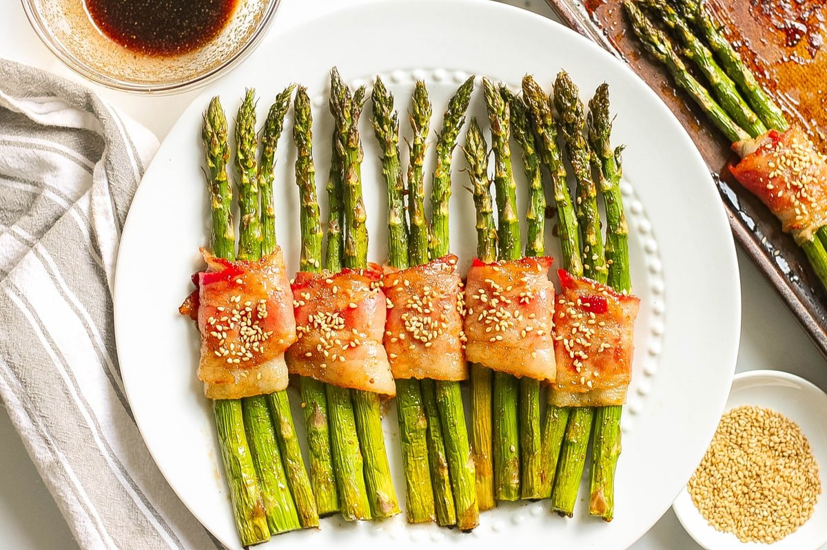 bacon wrapped asparagus on a serving plate