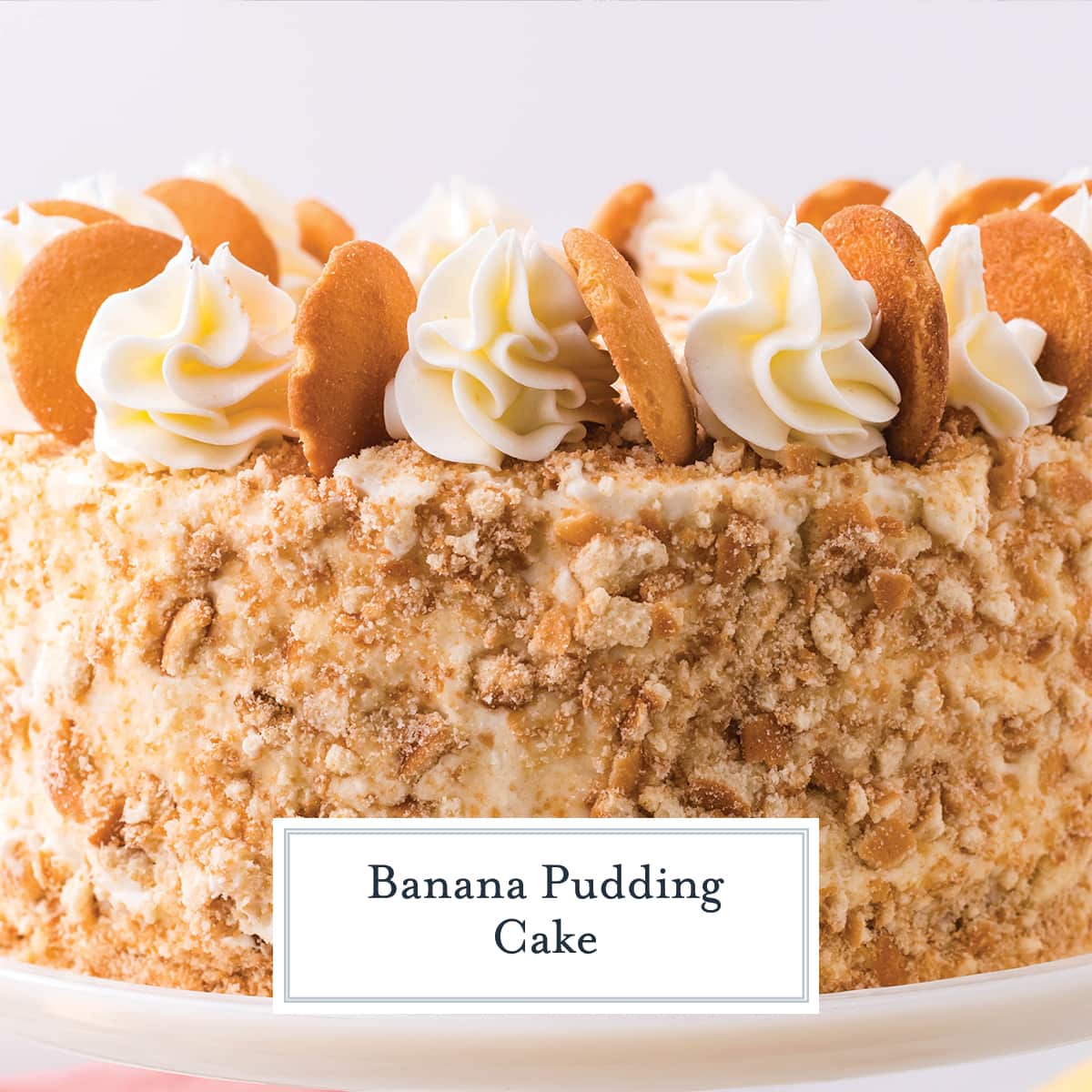 close up of nilla cookie crumbs on banana pudding layer cake