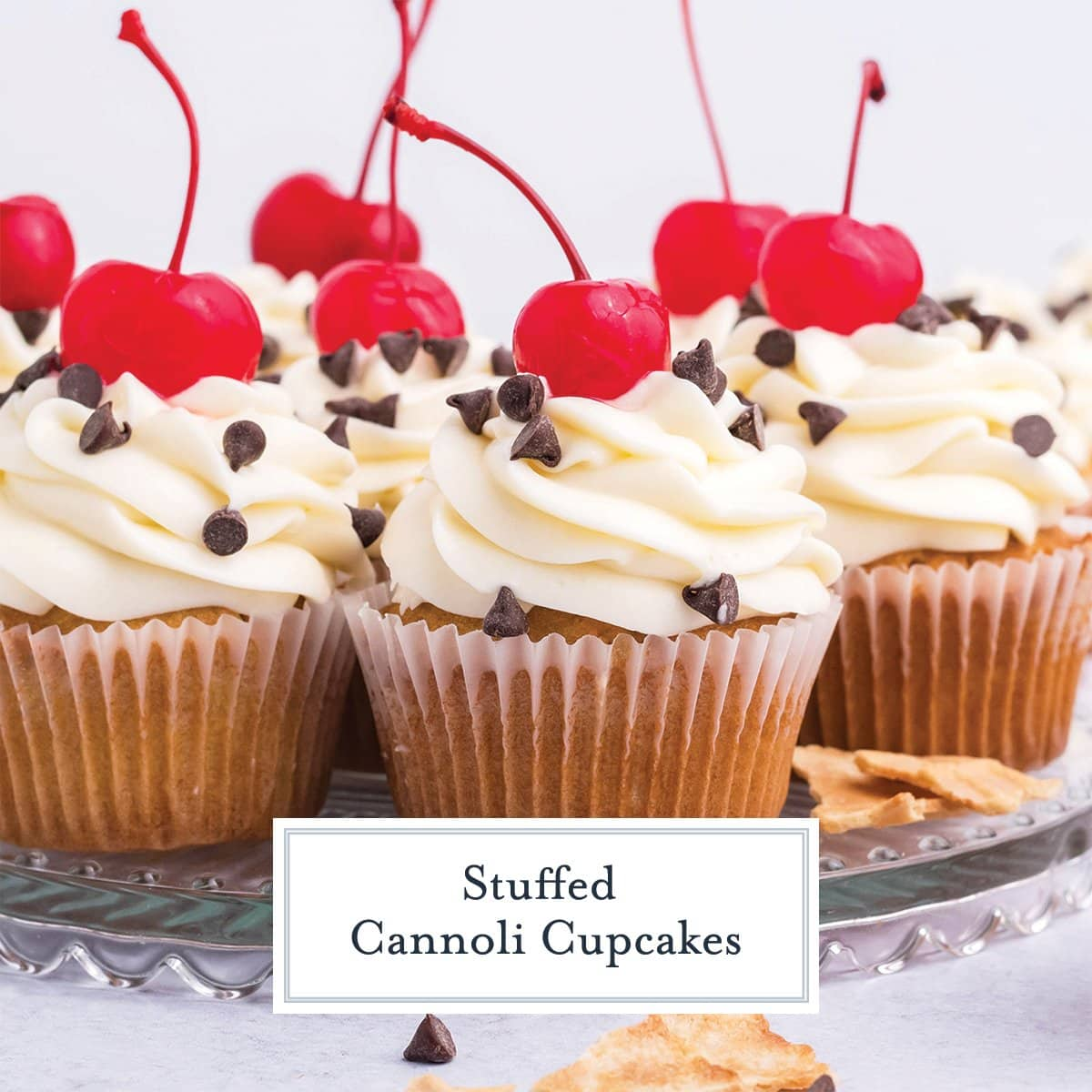 close up of cannoli cupcakes with chocolate chips and a cherry