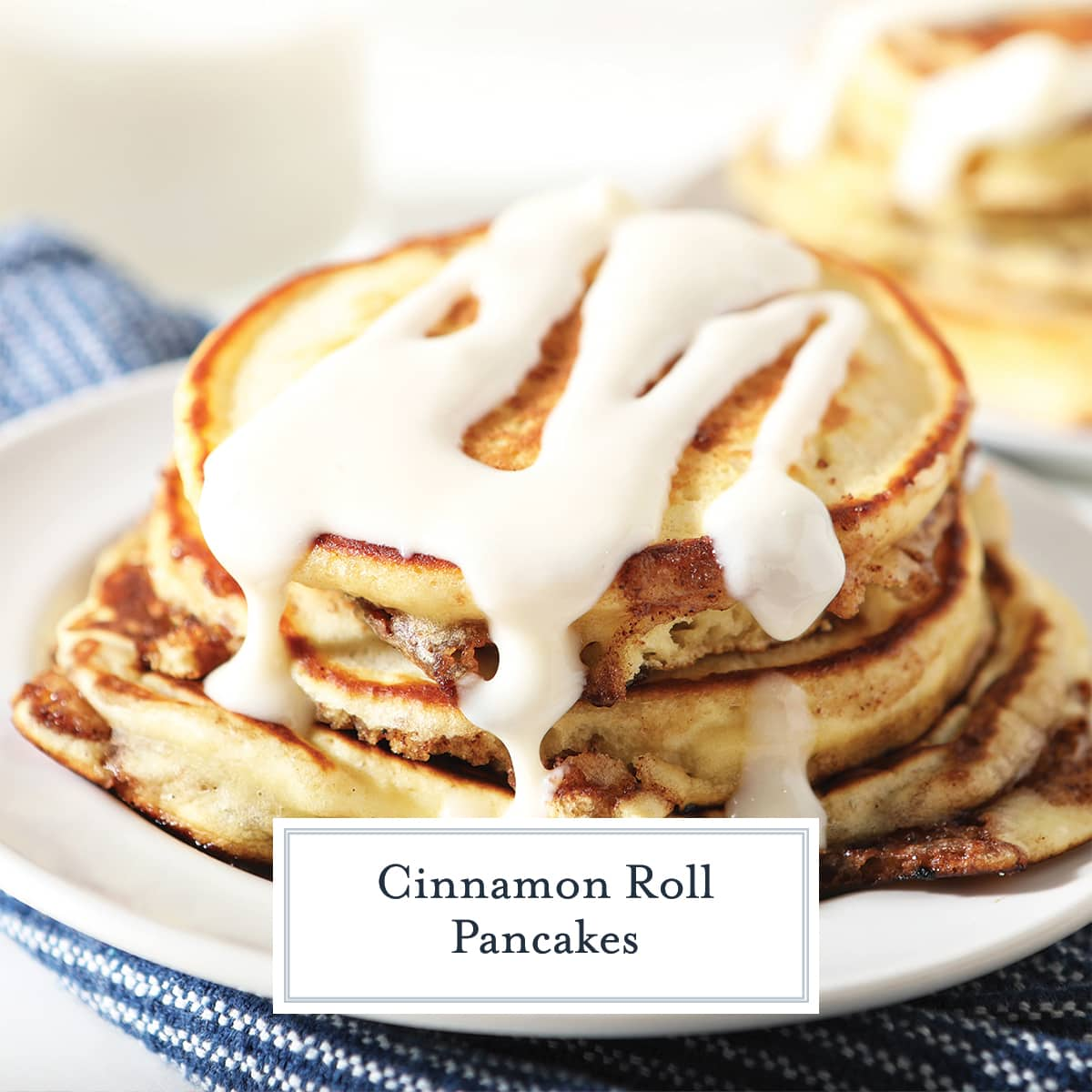 close up stack of cinnamon roll pancakes