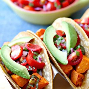 sweet potato tacos with avocado in a holder