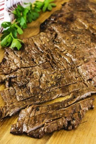 overhead of sliced skirt steak on a cutting board