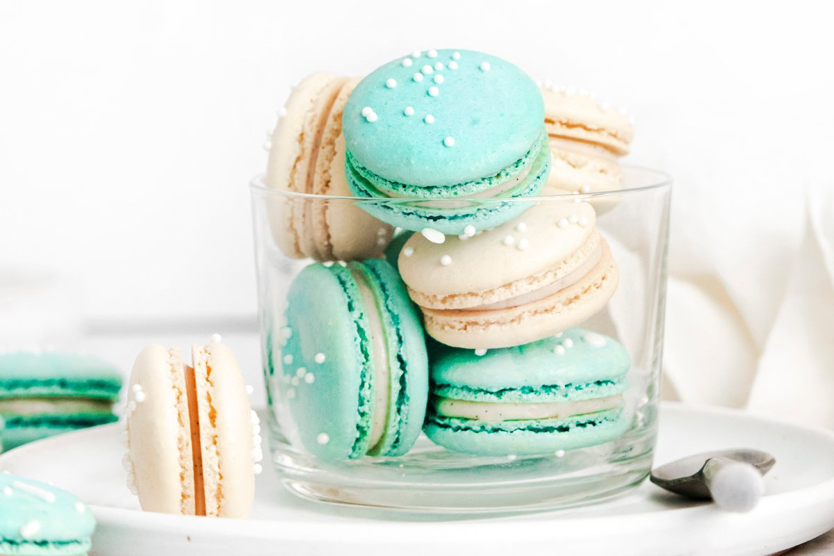 side view of vanilla macarons in teal and white