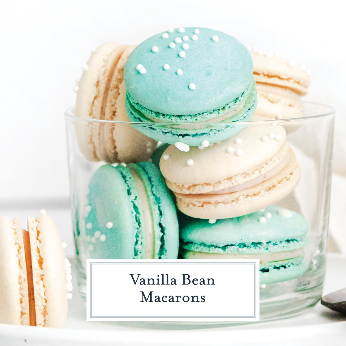 teal and white macarons in a glass