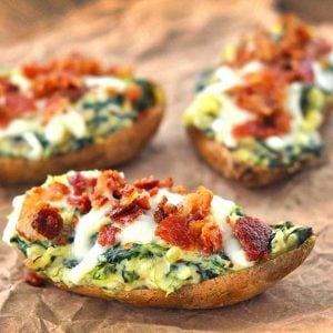 spinach stuffed sweet potatoes on parchment paper
