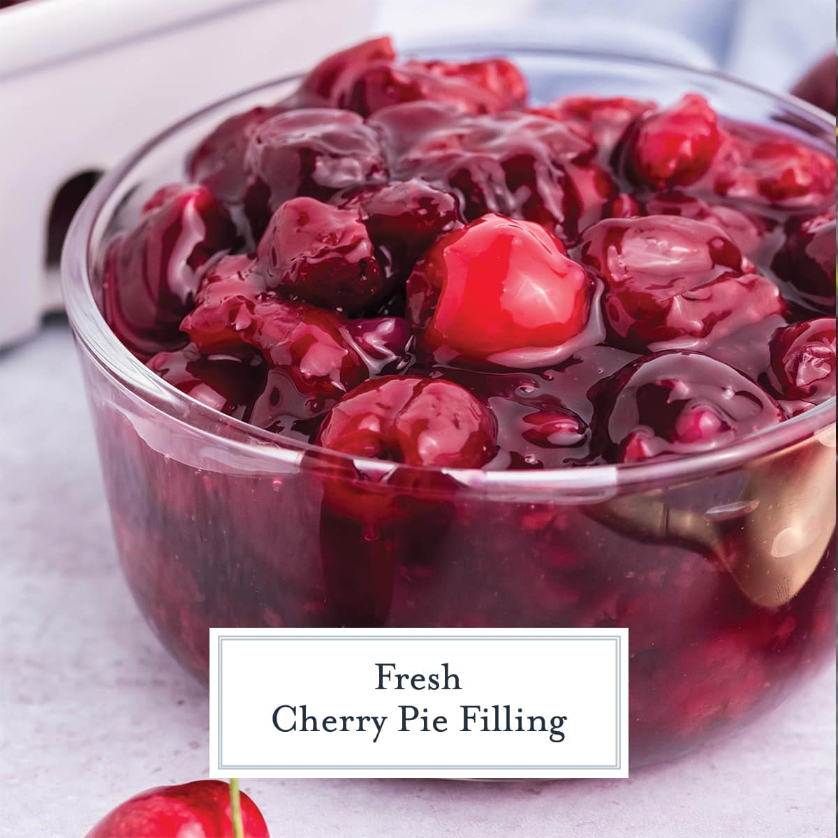 close up of cherry pie filling in a glass bowl