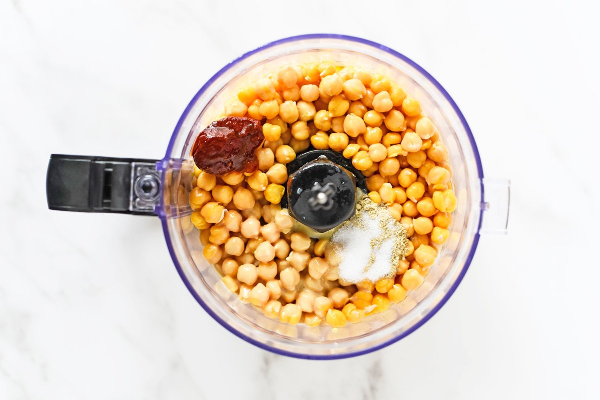 ingredients in a food processor for spicy hummus