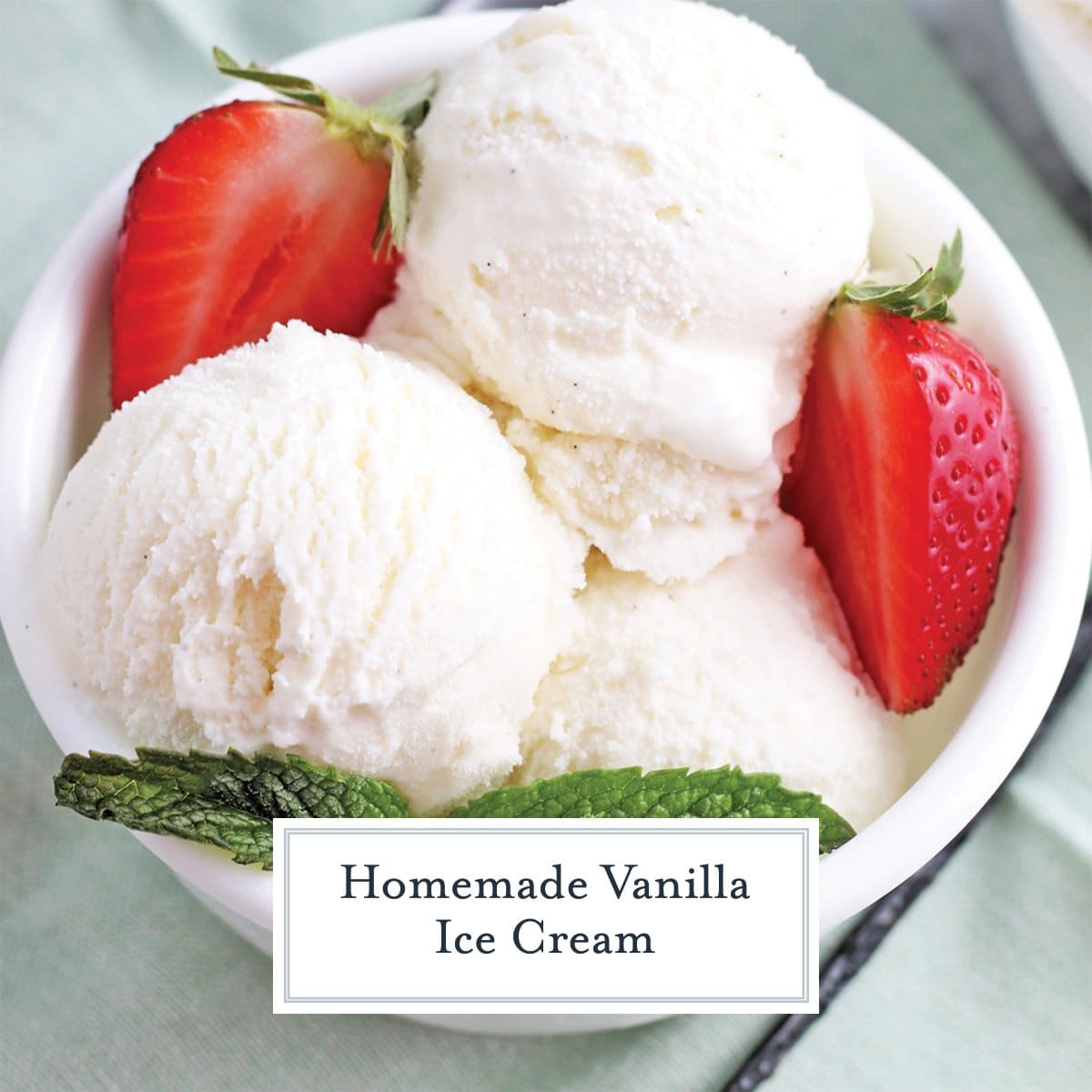 close up of scoops of vanilla ice cream with strawberries