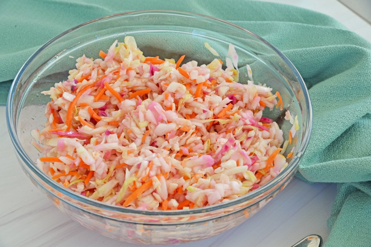 bowl of vinegar slaw with teal linen