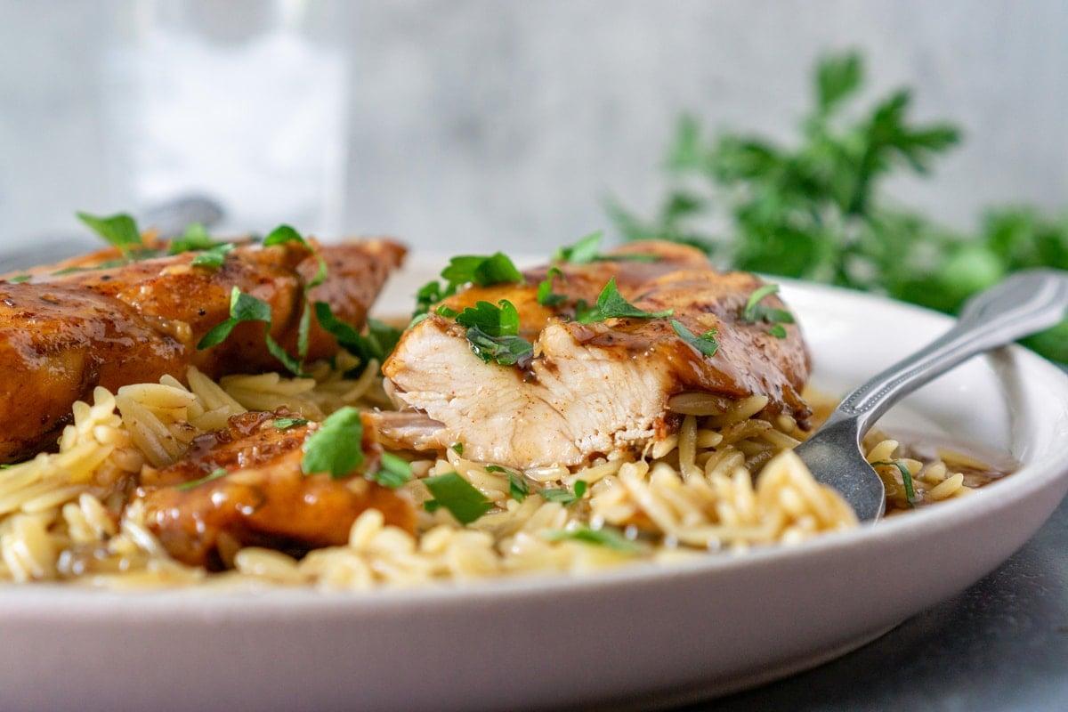 chicken breast cut in half over rice