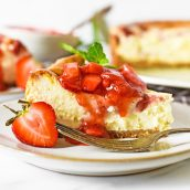 close up angle of cheesecake with strawberry topping